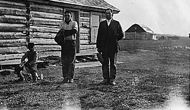 Picture shows Oliver and two of his children at his home.