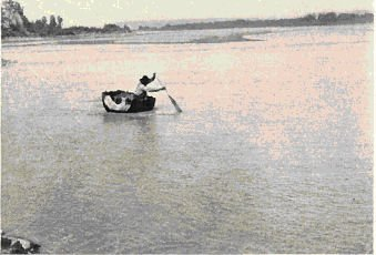 Fig. 5. Crossing the Missouri in a Bull-Boat. (Wilson photo.)