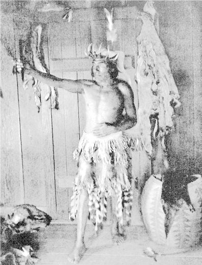 Leader of White Deerskin Dance with crown of horns and Medicine Stone - Hoopa Valley