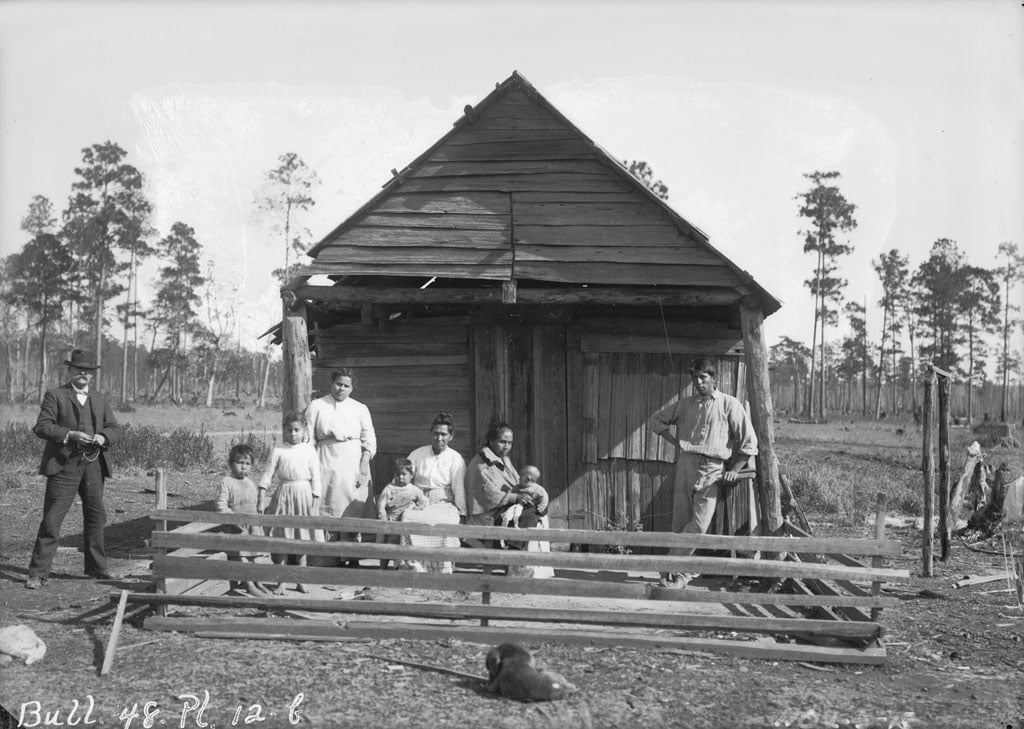 Group of Nine Near Wood Frame Building 1909, Photograph of Choctaws in Mississippi or Louisiana
