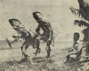 Navajos dance on a beach in the Solomons