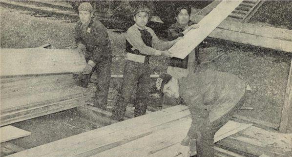 Indians unload Oregon timber at Naval Supply Depot