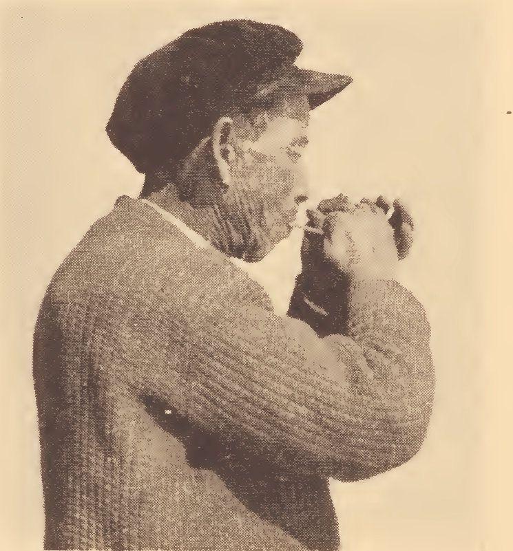 Pamunkey hunter demonstrating method of calling wild turkey with a wing-bone call